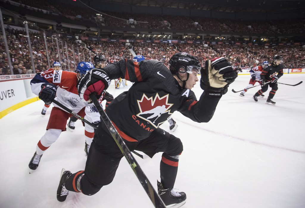 Canada's Jaret Anderson-Dolan, front, and Czech Republic's Jan Hladonik, back left, skate after the puck during first-period IIHF world junior hockey ...