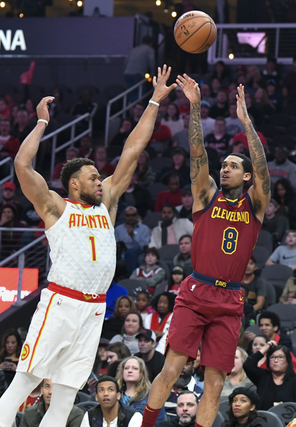 Cleveland Cavaliers guard Jordan Clarkson (8) shoots with Atlanta Hawks guard Justin Anderson defending during the first half of an NBA basketball gam...