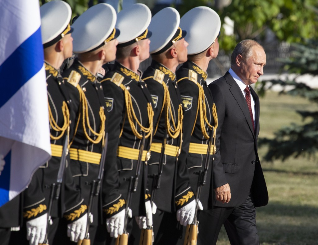 FILE - In this file photo taken on Thursday, Aug. 23, 2018, Russian President Vladimir Putin, right, arrives to attend a laying ceremony in Kursk, 426...