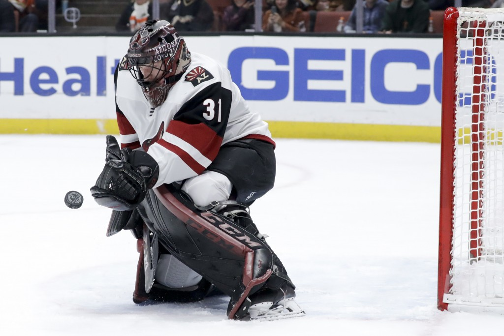 Arizona Coyotes goaltender Adin Hill blocks a shot during the second period of the team's NHL hockey game against the Anaheim Ducks in Anaheim, Calif....