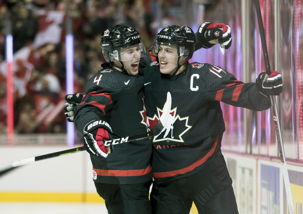 Canada's Jared McIsaac, left, and Maxime Comtois celebrate Comtois' goal against the Czech Republic during first-period IIHF world junior hockey champ...