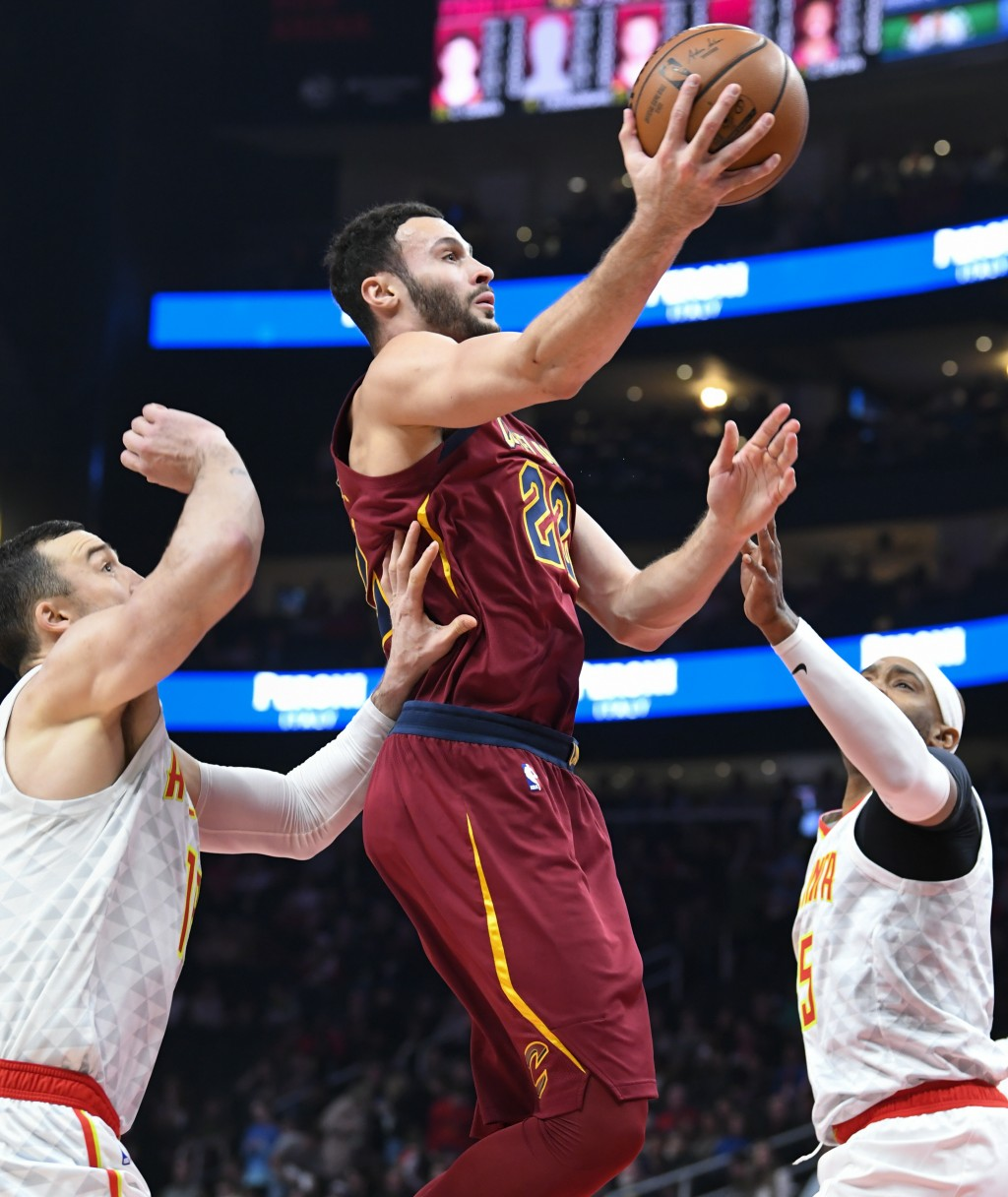 Cleveland Cavaliers forward Larry Nance Jr., center, shoots as Atlanta Hawks center Miles Plumlee, left, and forward Vince Carter, right, defend durin...