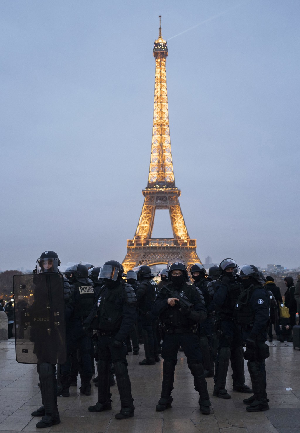 French riot police officers take position on the Trocadero plaza during a demonstration in Paris, Saturday, Dec. 29, 2018. Yellow vest protesters marc...