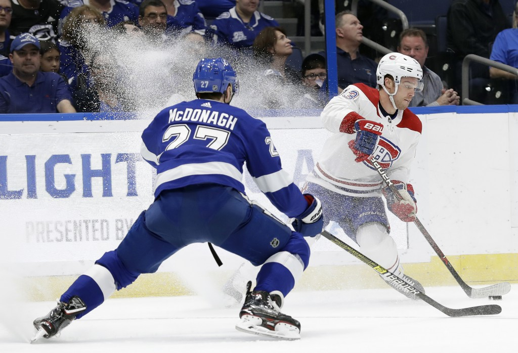 Montreal Canadiens center Max Domi (13) stops short in front of Tampa Bay Lightning defenseman Ryan McDonagh (27) during the first period of an NHL ho...