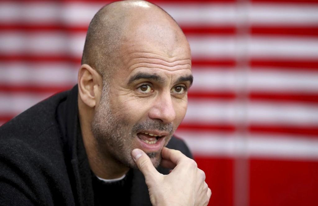 Manchester City manager Pep Guardiola looks out prior to the match against Southampton, during their English Premier League soccer match at St Mary's ...
