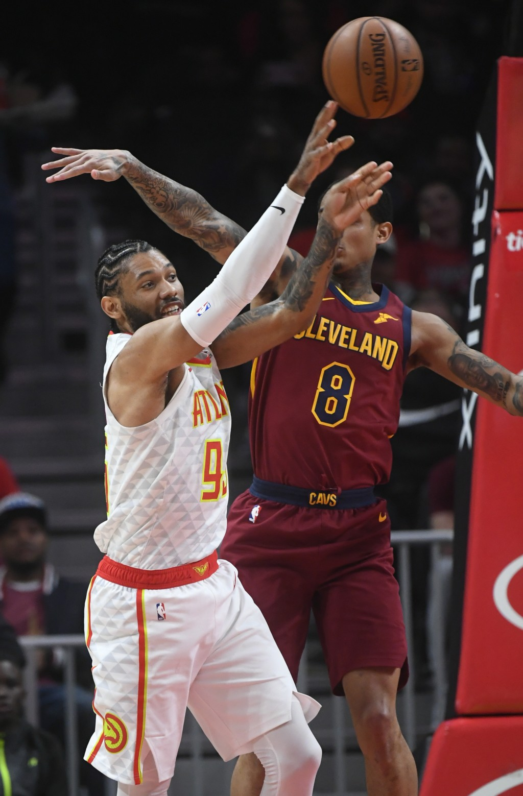 Atlanta Hawks forward DeAndre' Bembry (95) passes as Cleveland Cavaliers guard Jordan Clarkson defends during the first half of an NBA basketball game...