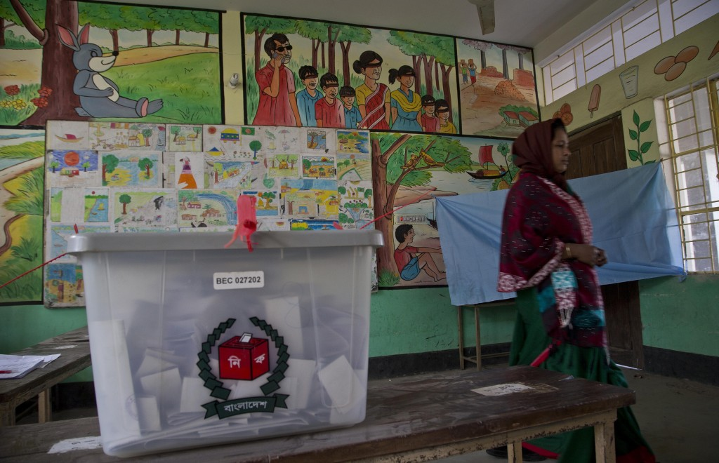 A Bangladeshi woman leaves after casting her vote at a polling station in the ancient city of Panam Nagar, about 20 kilometers (12 miles) southeast of...
