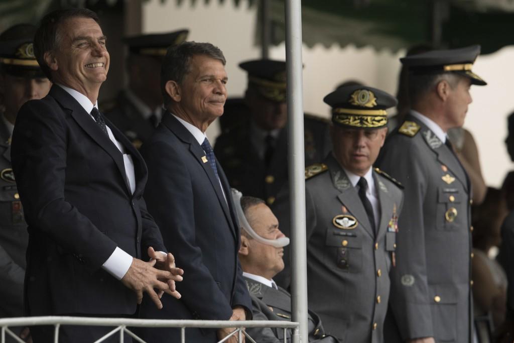 In this Dec. 1, 2018 photo, Brazil's President-elect Jair Bolsonaro, left, and  Minister of Defense, Gen.Joaquim Silva e Luna, attend a graduation cer...