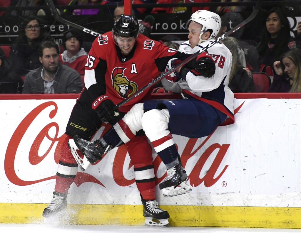 Ottawa Senators left wing Zack Smith (15) collides with Washington Capitals defenseman Tyler Lewington (78) during the second period of an NHL hockey ...