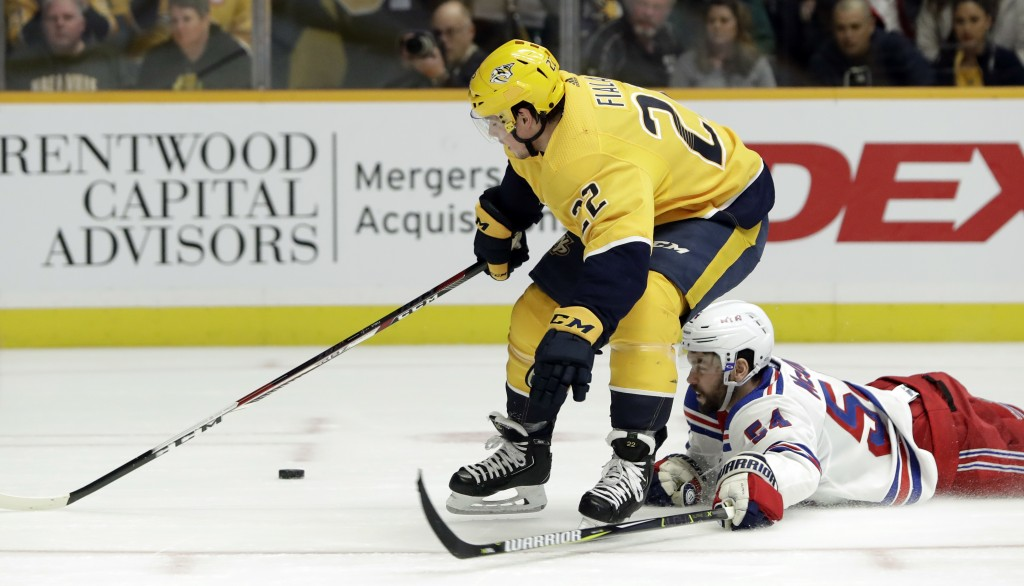 New York Rangers defenseman Adam McQuaid (54) tries to stop Nashville Predators left wing Kevin Fiala (22), of Switzerland, in the second period of an...