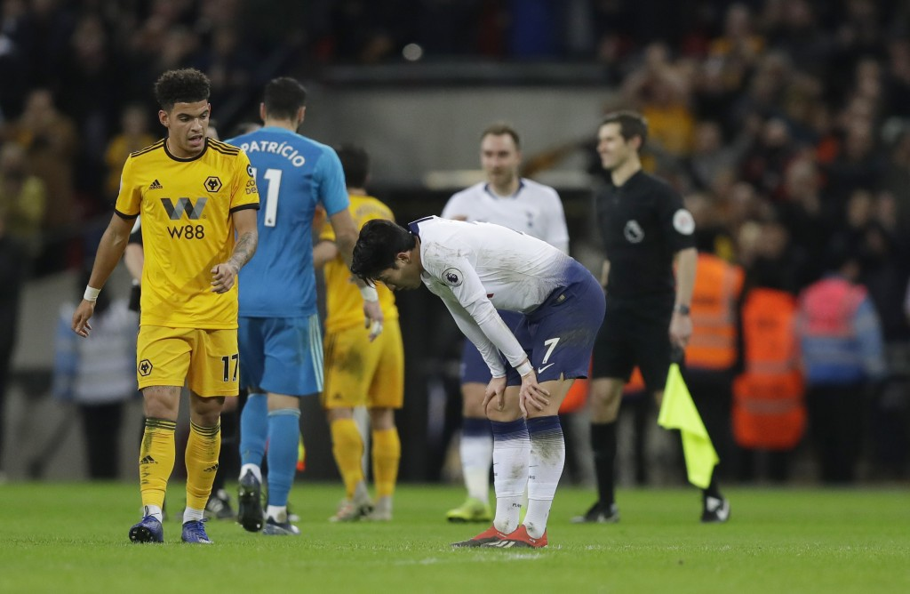 Tottenham Hotspur's Son Heung-min, bends down after the end of the English Premier League soccer match between Tottenham Hotspur and Wolverhampton Wan...