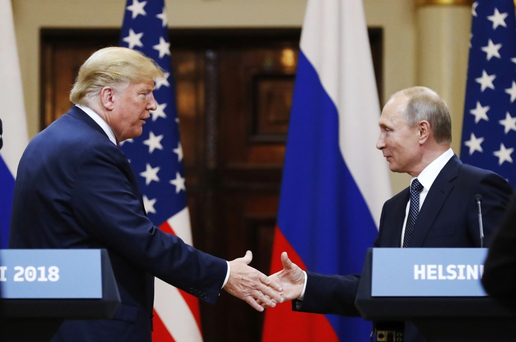 FILE In this file photo taken on Monday, July 16, 2018, U.S. President Donald Trump shakes hand with Russian President Vladimir Putin at the end of th...