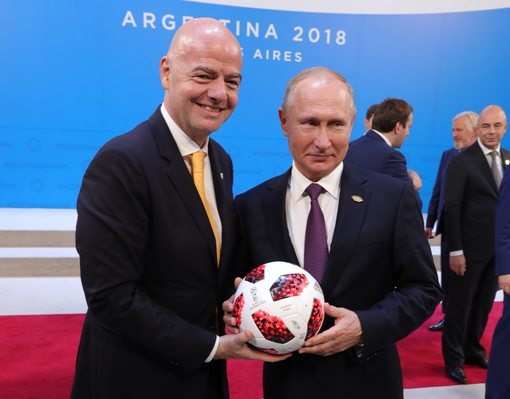 FILE In this file photo taken on Friday, Dec. 28, 2018, Russian President Vladimir Putin, right, and FIFA President Gianni Infantino pose for a photo ...