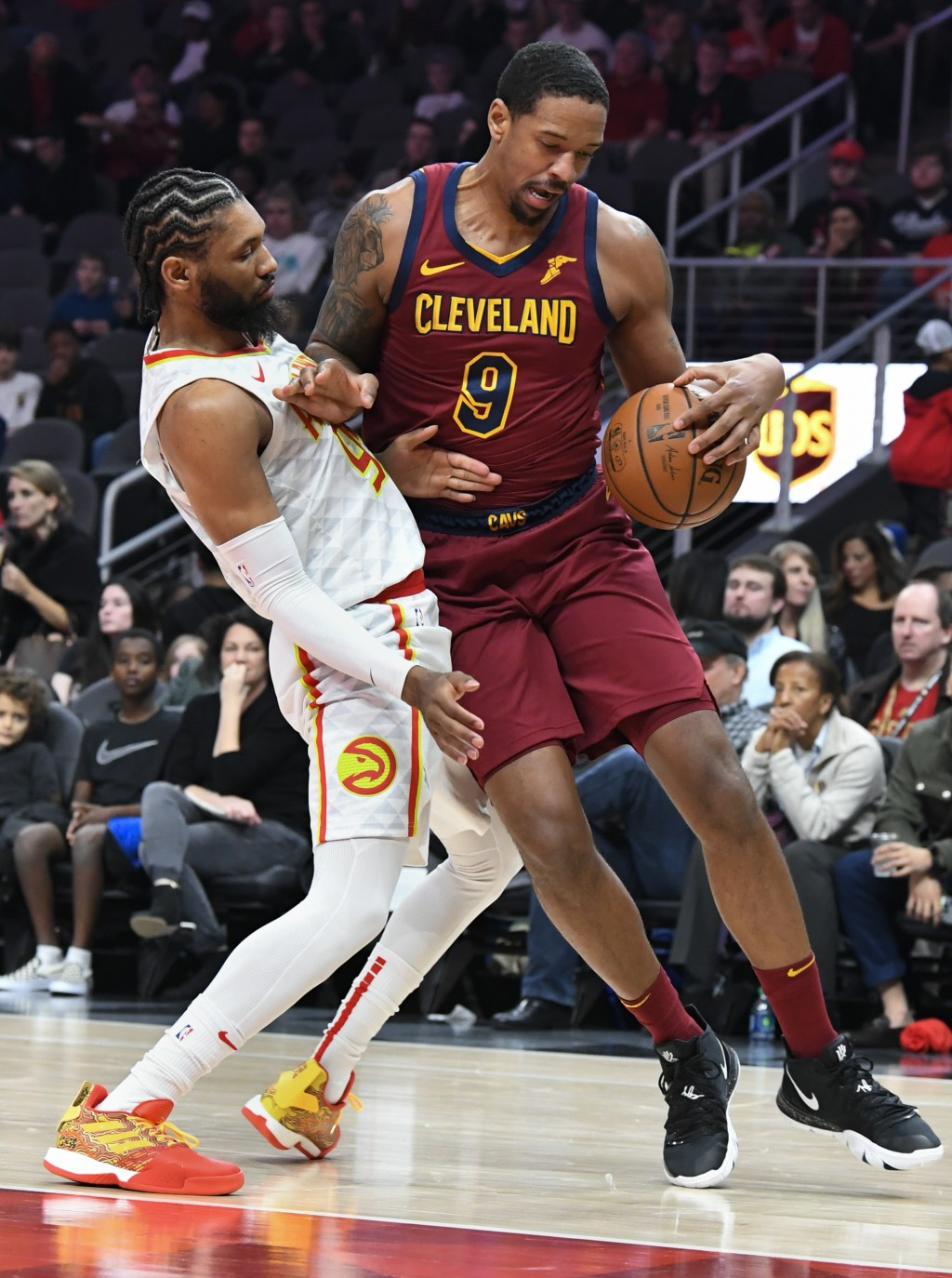 Cleveland Cavaliers forward Channing Frye (9) is defended by Atlanta Hawks forward DeAndre' Bembry during the first half of an NBA basketball game, Sa...