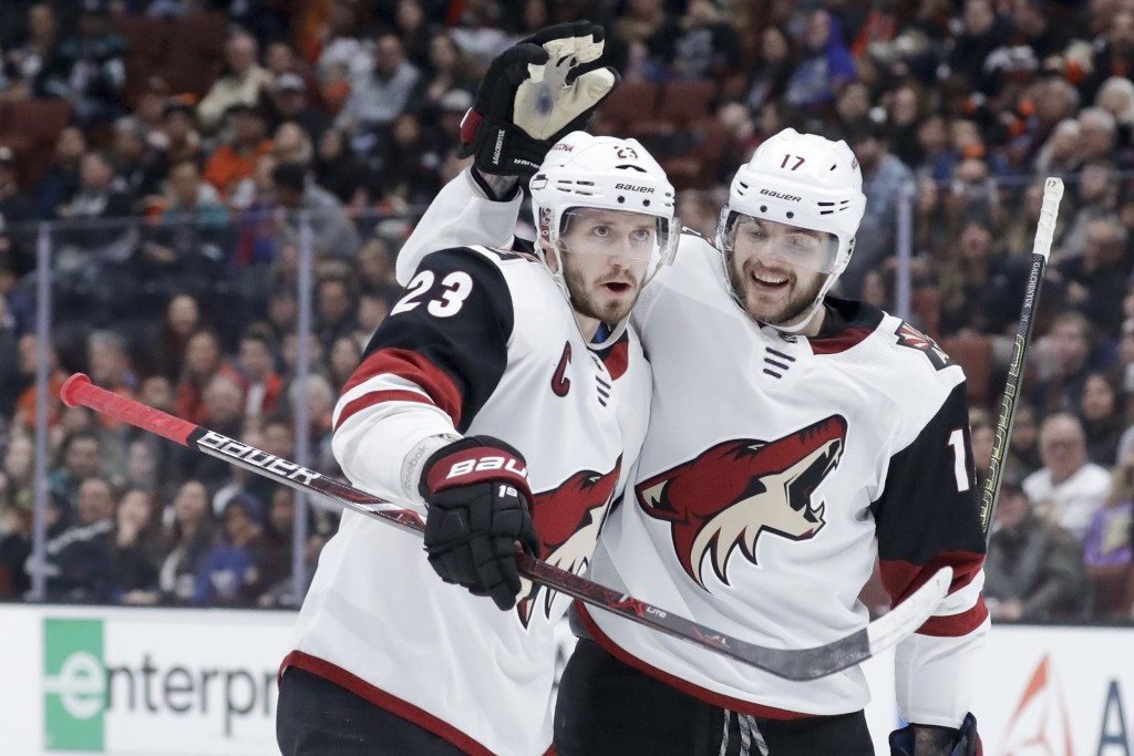 Arizona Coyotes defenseman Oliver Ekman-Larsson, left, celebrates after scoring after with center Alex Galchenyuk during the first period of an NHL ho...