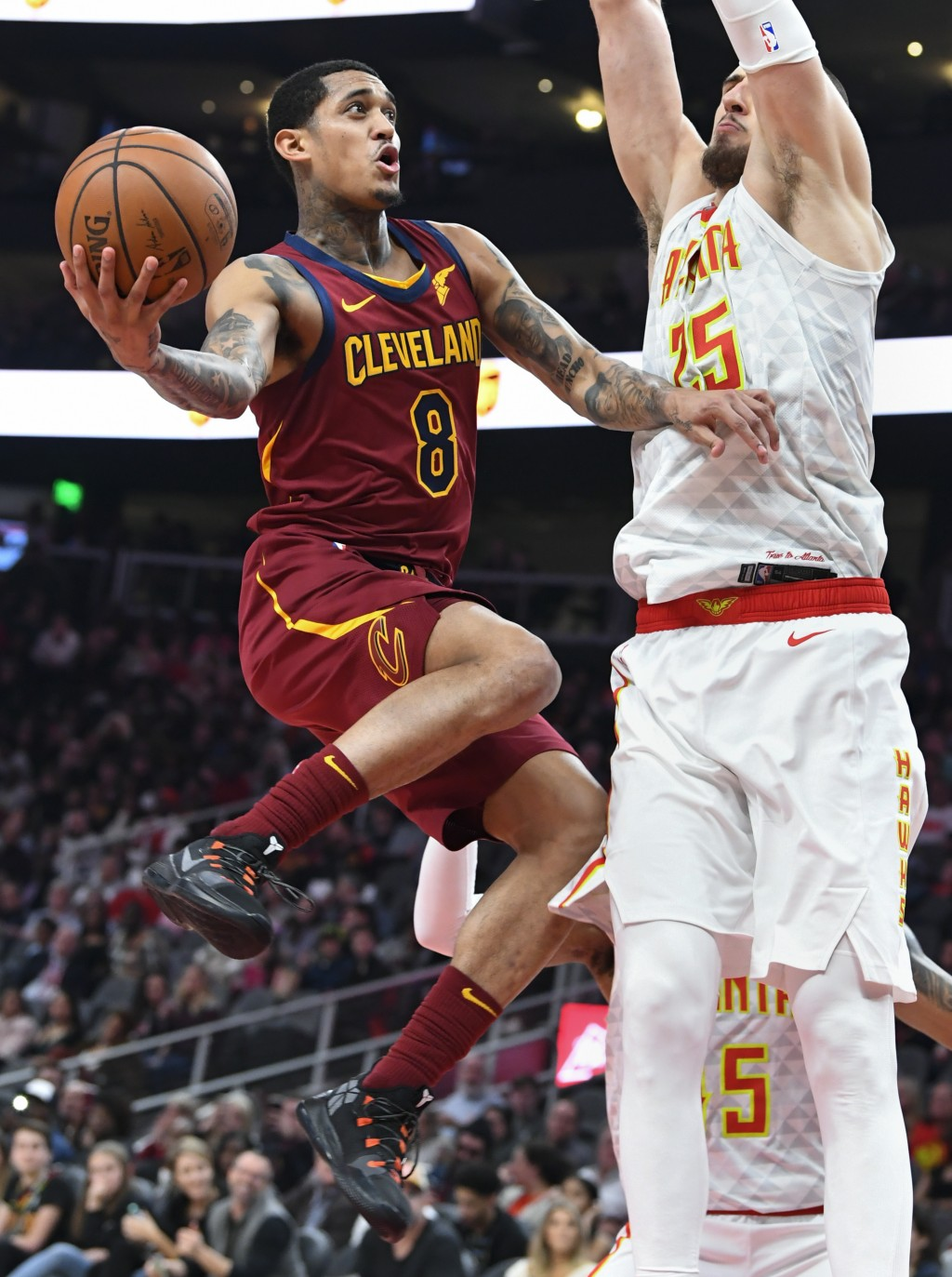 Cleveland Cavaliers guard Jordan Clarkson (8) goes up against the defense of Atlanta Hawks center Alex Len (25) during the first half of an NBA basket...