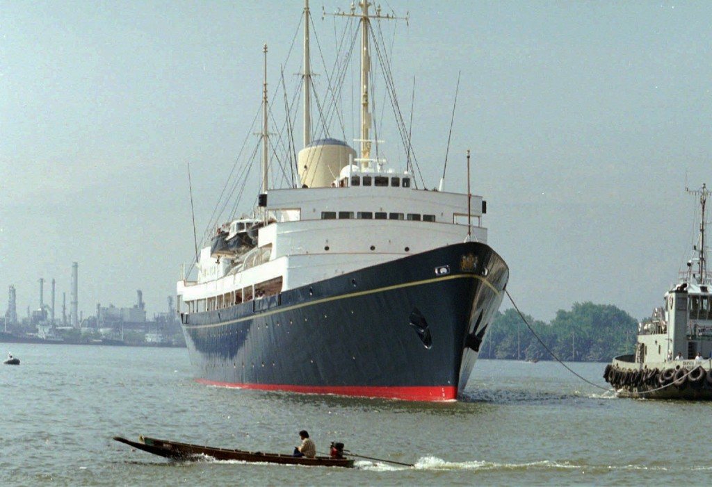 FILE - In this Friday, May 9, 1997 file photo, a long-tailed boat passes by the British Royal Yacht Britannia as it is tugged to port in Bangkok. A ne...