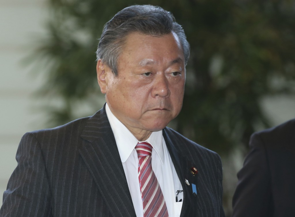 FILE - In this Oct. 2, 2018, file photo, Japan's Minister in Charge of Tokyo Olympics Yoshitaka Sakurada arrives at the prime minister's official resi...
