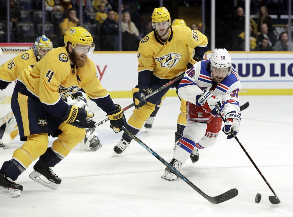 New York Rangers right wing Mats Zuccarello (36), of Norway, reaches for the puck with Nashville Predators defenseman Ryan Ellis (4) in the first peri...