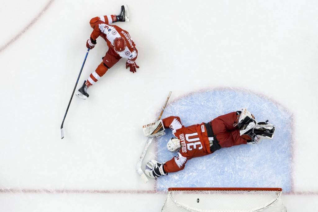 Denmark goalie Mads Soegaard (30) lies on the ice after allowing a goal to Switzerland's Philipp Kurashev (not shown) as Switzerland's Marco Lehmann (...