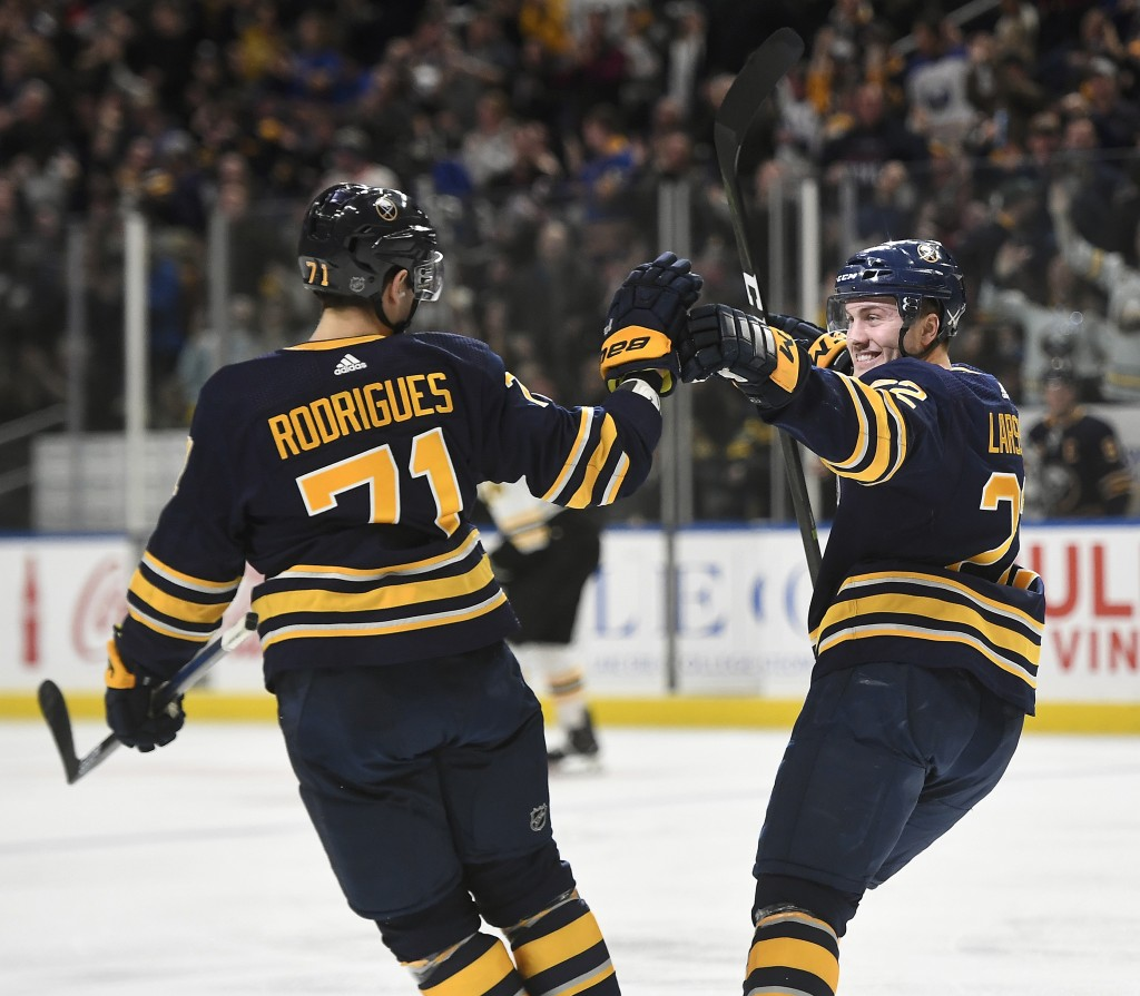 Buffalo Sabres center Johan Larsson, right, celebrates his short-handed goal with left wing Evan Rodrigues during the second period of an NHL hockey g...