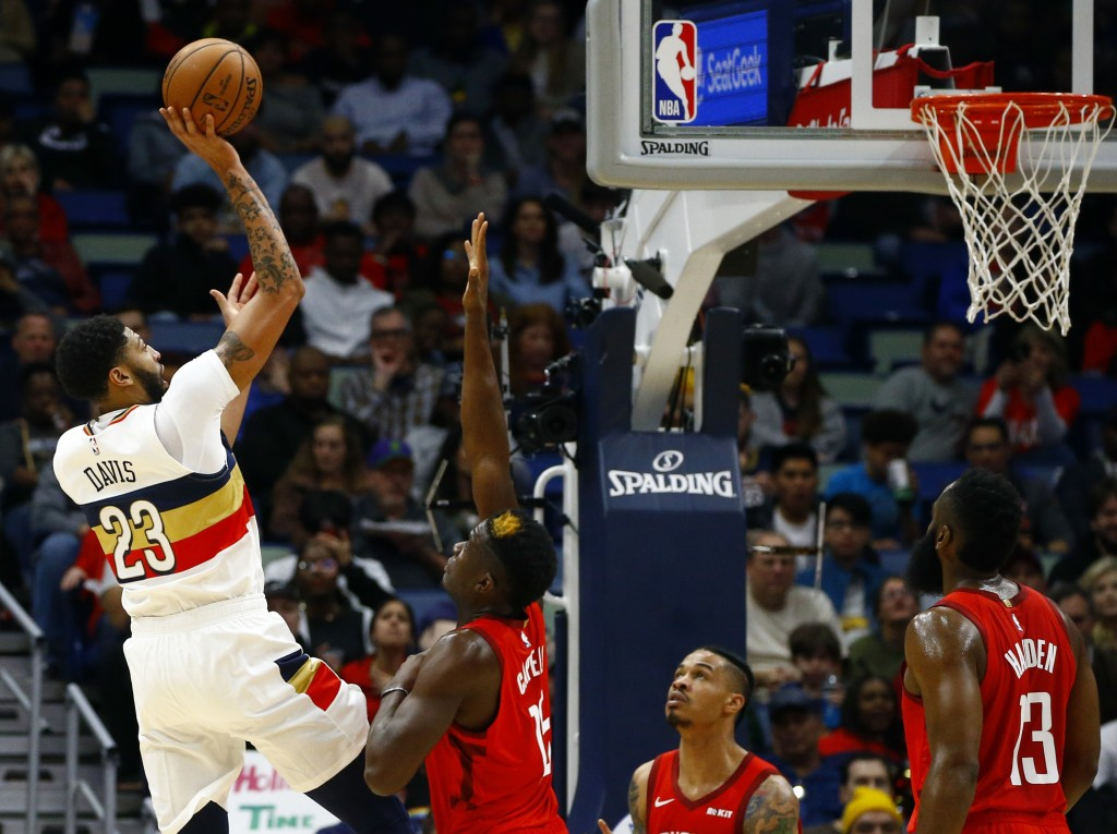 New Orleans Pelicans forward Anthony Davis (23) puts up a shot over Houston Rockets center Clint Capela (15) during the first half of an NBA basketbal...