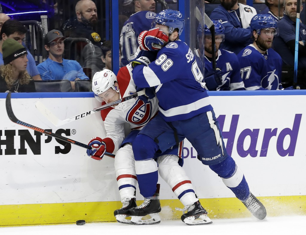Montreal Canadiens right wing Brendan Gallagher (11) and Tampa Bay Lightning defenseman Mikhail Sergachev (98) battle for the puck during the first pe...