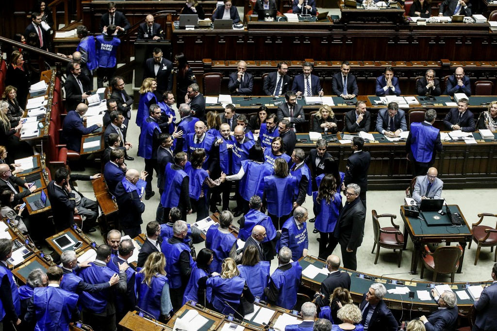 "Forza Italia party's lawmakers protest wearing blue vest reading ""stop taxes"" and ""hands off non-profit"", referring to increasing taxes on non-profit ..."