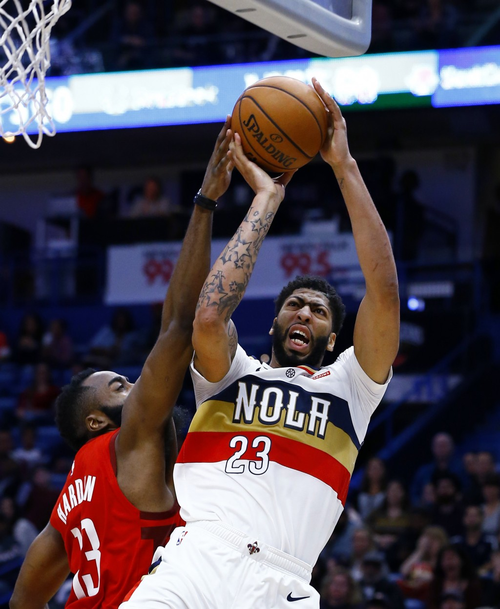 New Orleans Pelicans forward Anthony Davis (23) tries for a shot as Houston Rockets guard James Harden (13) defends during the second half of an NBA b...