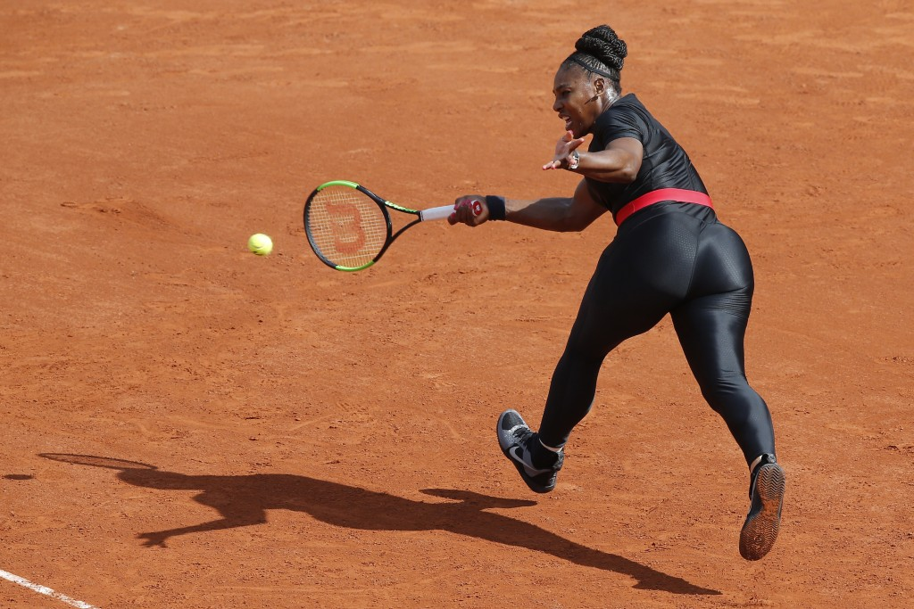 FILE - In this May 29, 2018, file photo, Serena Williams, of the United States, returns a shot against Krystyna Pliskova, of the Czech Republic, durin...