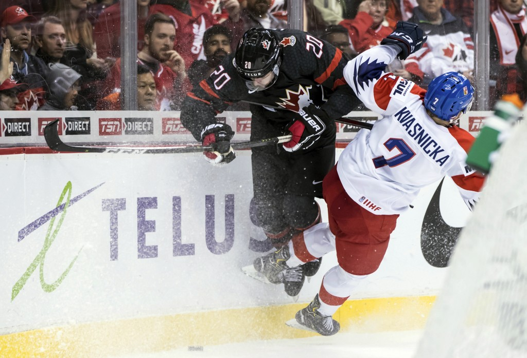 Canada's Brett Leason, left, and Czech Republic's David Kvasnicka collide during third-period IIHF world junior hockey championship game action in Van...