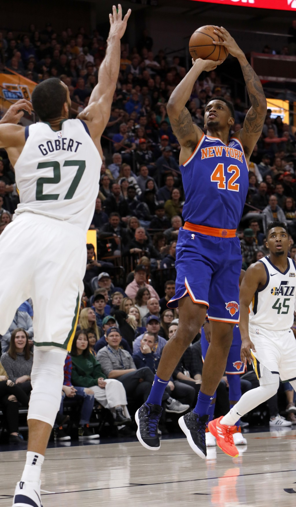 New York Knicks' Lance Thomas (42) shoots as Utah Jazz's Rudy Gobert (27) defends in the first half of an NBA basketball game on Saturday, Dec. 29, 20...