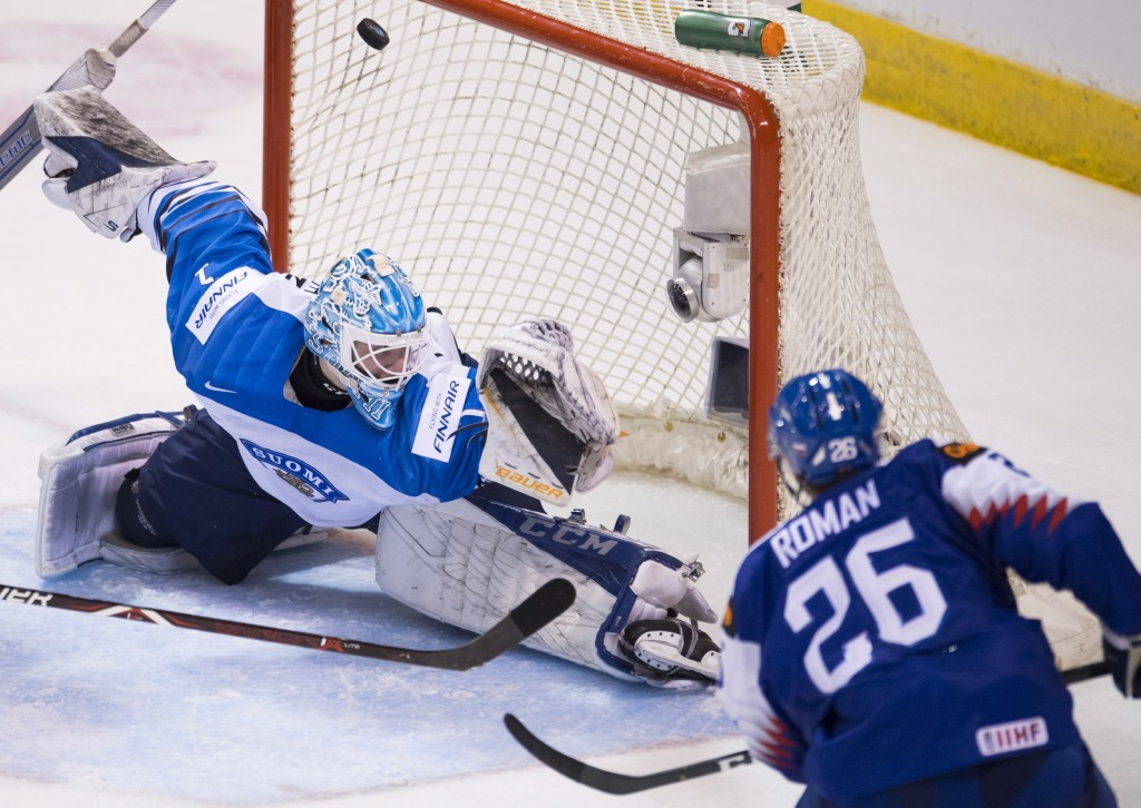 Slovakia's Milos Roman (26) sends a shot past Finland goaltender Ukko-Pekka Luukkonen (1) during the second period of a world junior hockey championsh...