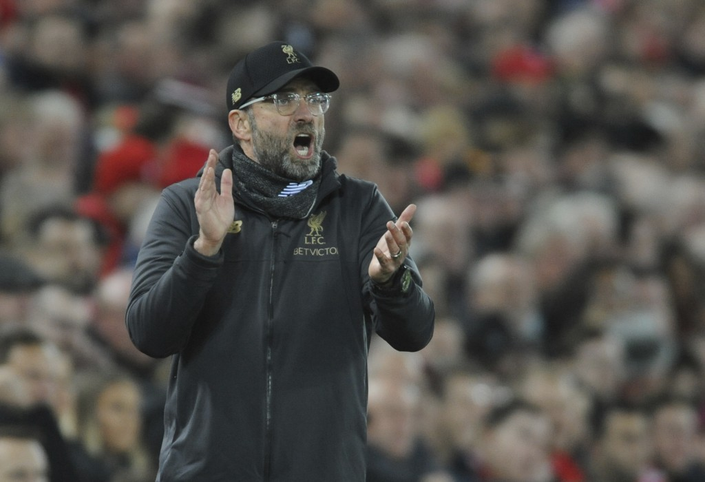 Liverpool's manager Jurgen Klopp gestures to his players during the English Premier League soccer match between Liverpool and Arsenal at Anfield in Li...