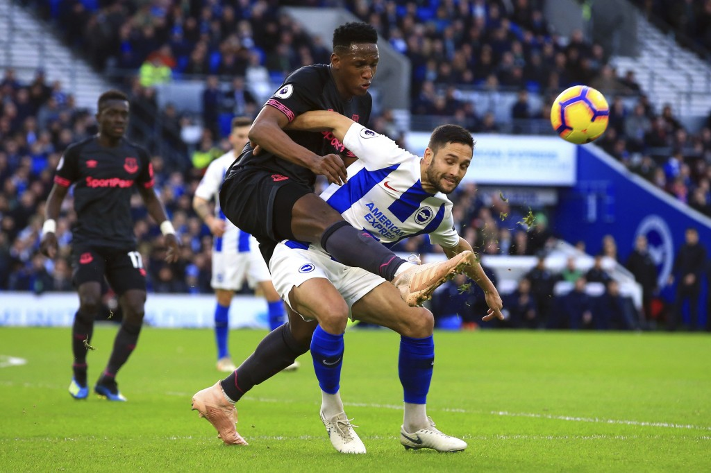 Brighton & Hove Albion's Florin Andone, right, and Everton's Yerry Mina during their English Premier League soccer match at the AMEX Stadium in Bright...
