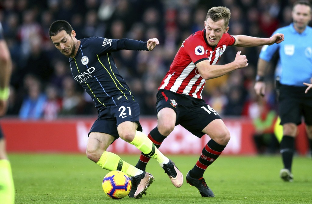 Manchester City's David Silva, left, and Southampton's James Ward-Prowse during their English Premier League soccer match at St Mary's Stadium in Sout...