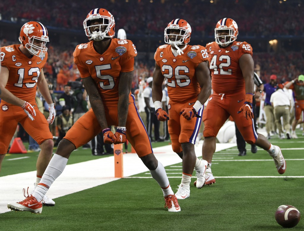 Clemson wide receiver Tee Higgins (5) celebrates his touchdown catch with wide receiver Hunter Renfrow (13), running back Adam Choice (26) and linebac...