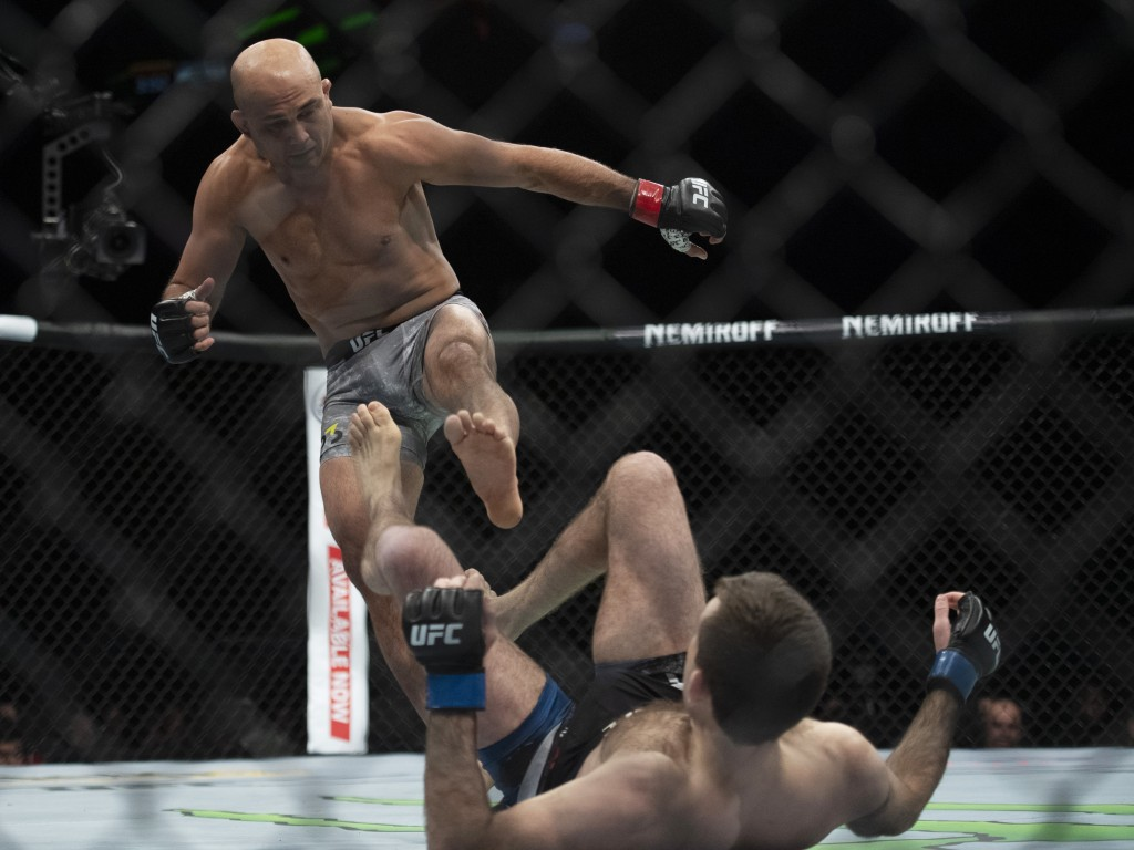 BJ Penn, top, fights Ryan Hall during the first round of a lightweight mixed martial arts bout at UFC 232, Saturday, Dec. 29, 2018, in Inglewood, Cali...