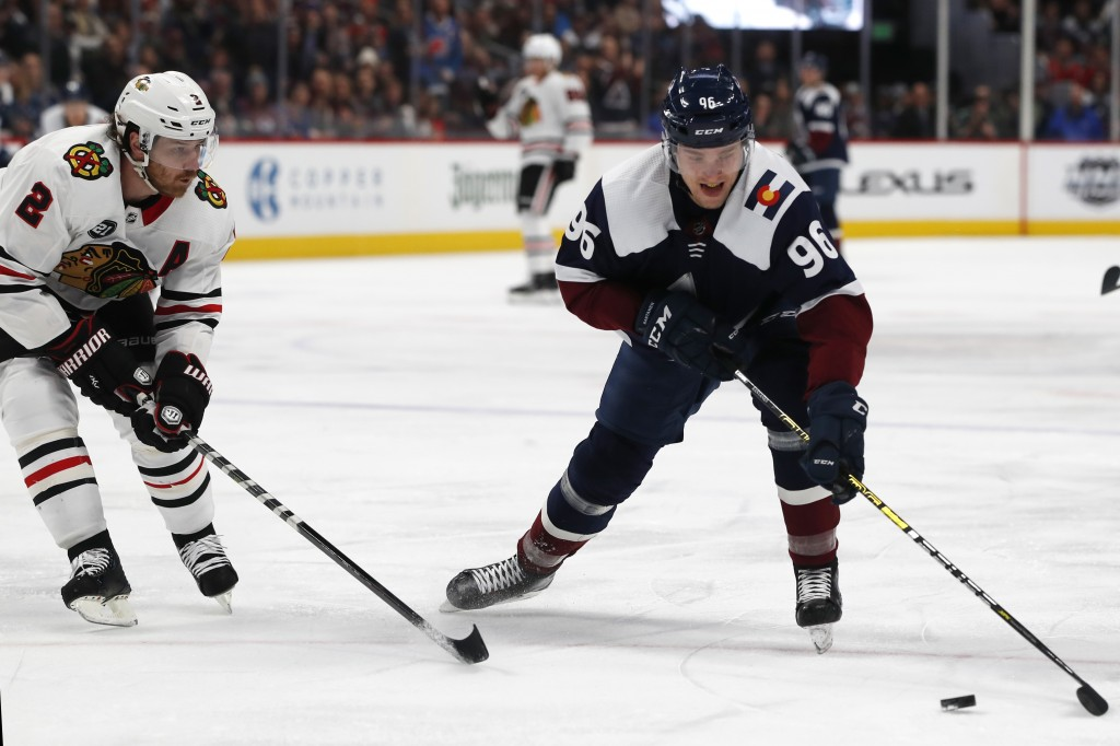 Colorado Avalanche right wing Mikko Rantanen, right, looks to shoot the puck as Chicago Blackhawks defenseman Duncan Keith covers in the first period ...
