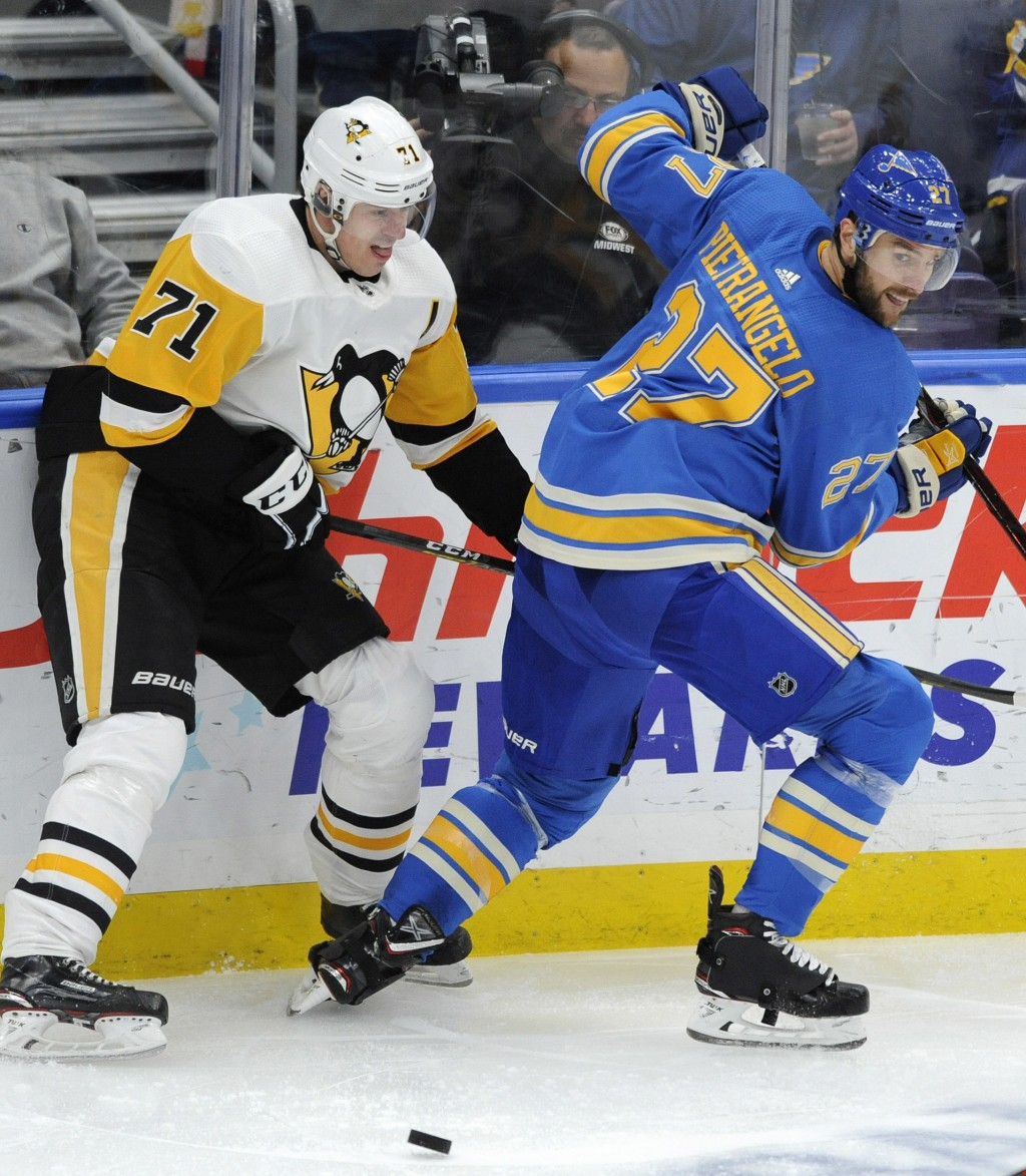 Pittsburgh Penguins' Evgeni Malkin (71), of Russia, looks at the puck, next to St. Louis Blues' Alex Pietrangelo (27) during the second period of an N