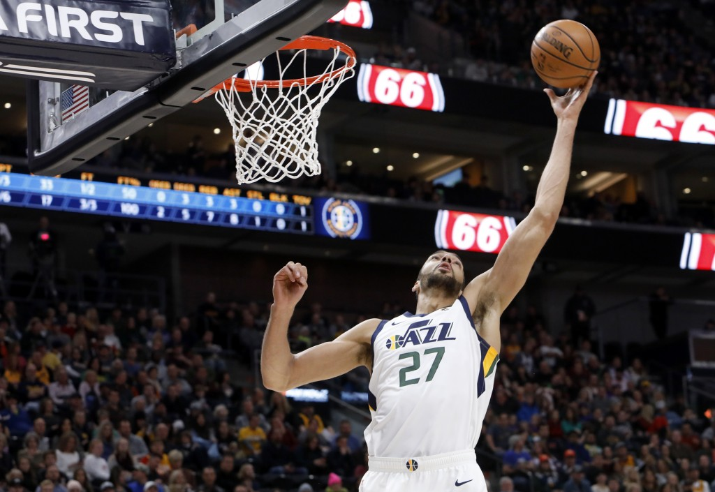 Utah Jazz's Rudy Gobert rebounds the ball in the first half of an NBA basketball game against the New York Knicks on Saturday, Dec. 29, 2018, in Salt ...