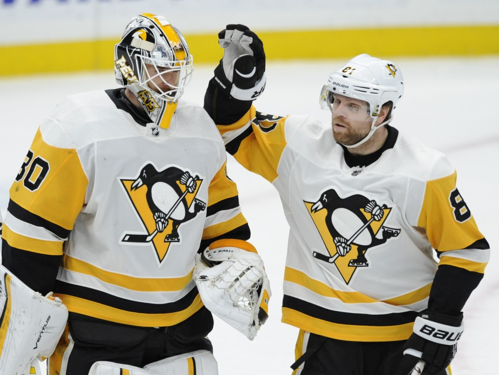 Pittsburgh Penguins goalie Matt Murray (30) is congratulated by Phil Dessel (81) after the team's 6-1 victory over the St. Louis Blues in an NHL hocke