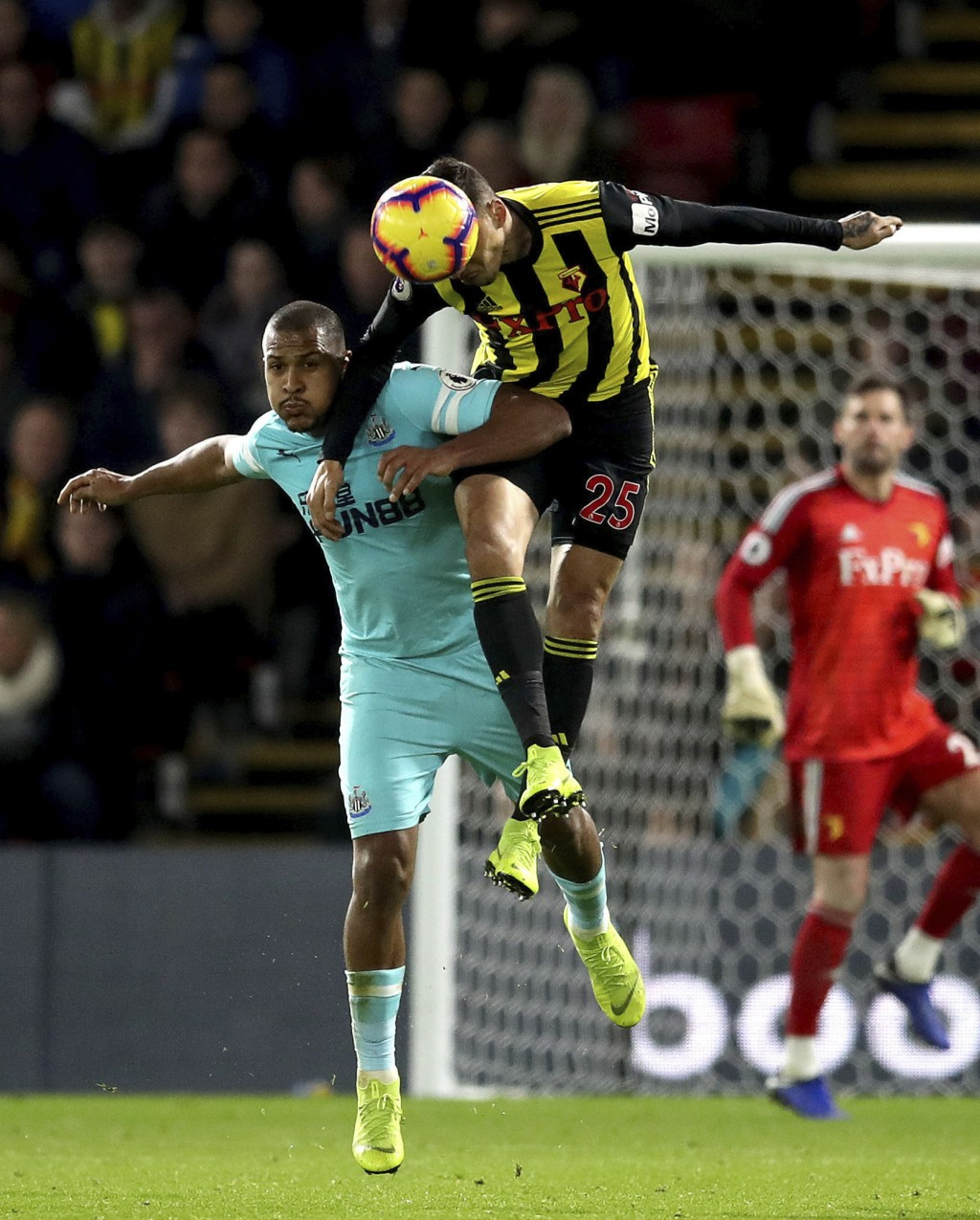 Newcastle United's Salomon Rondon, left, and Watford's Jose Holebas during their English Premier League soccer match, at Vicarage Road in Watford, Lon...