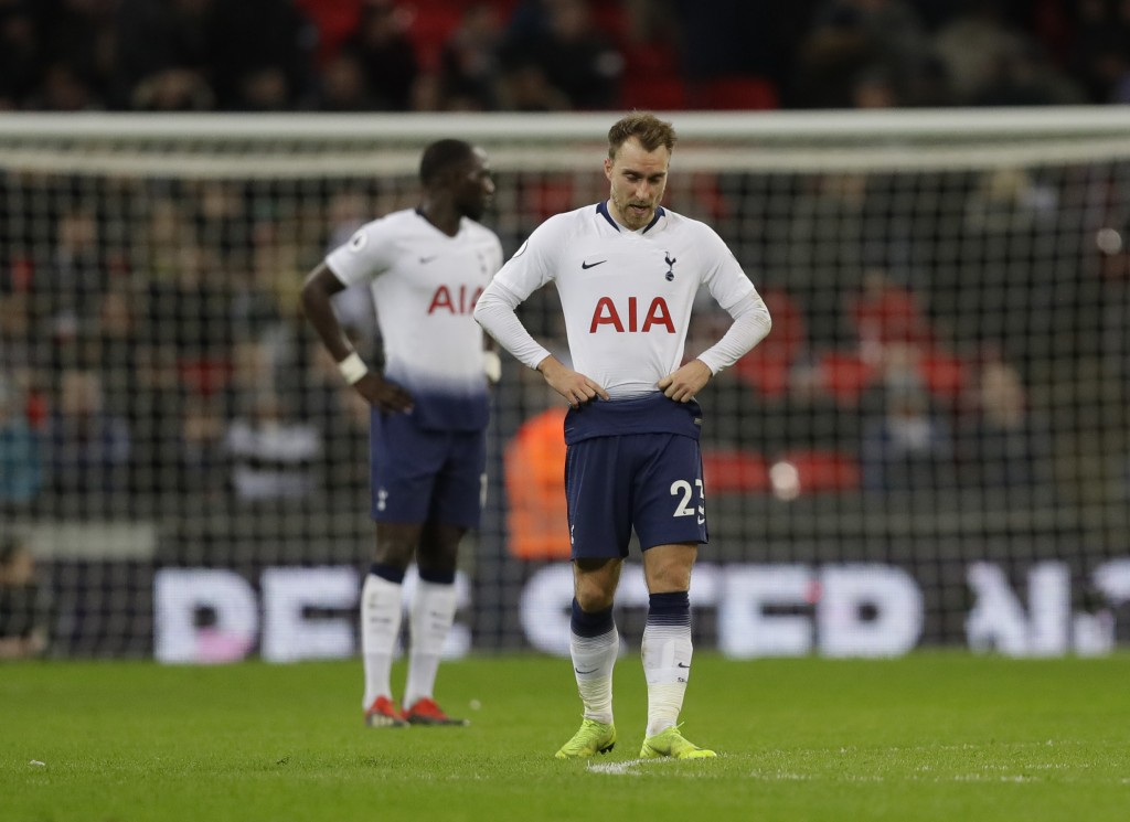 Tottenham Hotspur's Christian Eriksen, waits in the centre circle and looks down as he waits to restart the match after Wolverhampton Wanderers scored...