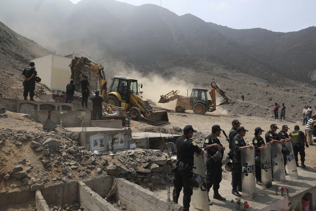 Peruvian authorities demolish a Shining Path mausoleum in a cemetery on the outskirts of Lima, Peru, Saturday, Dec. 29, 2018.  Peruvian authorities de...