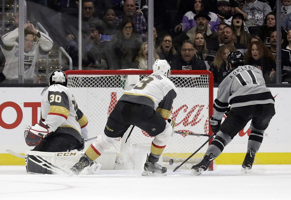 Los Angeles Kings center Anze Kopitar, right, scores past Vegas Golden Knights' Brayden McNabb, center, and goaltender Malcolm Subban (30) during the ...
