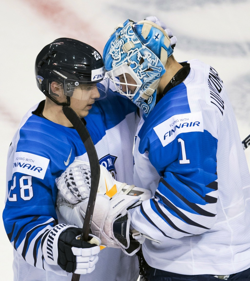 Finland's Ukko-Pekka Luukkonen goaltender celebrates his team's win over Slovakia with Sami Moilanen (28) following the third period of a world junior...