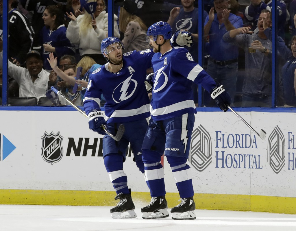 Tampa Bay Lightning defenseman Anton Stralman (6) celebrates his goal against the Montreal Canadiens with right wing Ryan Callahan (24) during the fir...