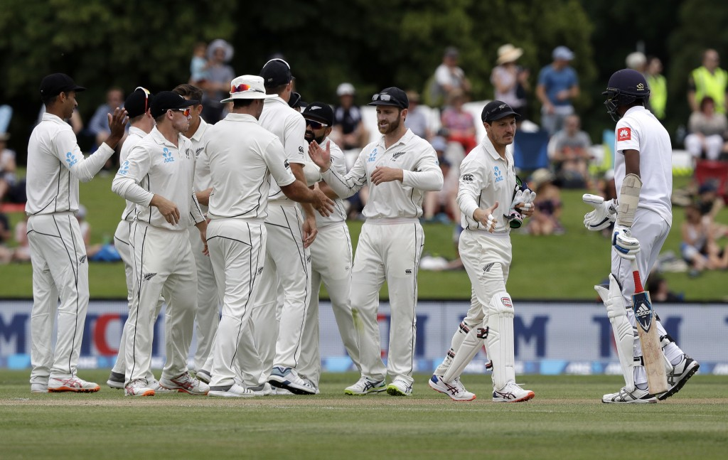 New Zealand players celebrate after defeating Sri Lanka by 423 runs on the final day of the second cricket test at Hagley Oval in Christchurch, New Ze...