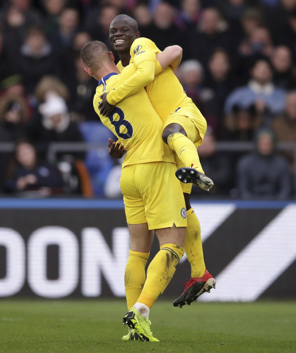 Chelsea's N'Golo Kante, top, celebrates scoring his side's first goal of the game against Crystal Palace, with teammate Ross Barkley, during their Eng...